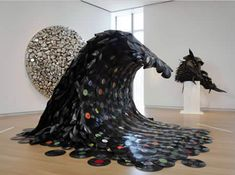 "Jean Shin created Sound Wave out of melted vinyl records. The sculpture was part of The Museum of Art and Design's exhibit ""Second Lives: Remixing the Ordinary."" The artist explained the sculpture shows ""the inevitable waves of technology that render each successive generation of recordable media obsolete."""