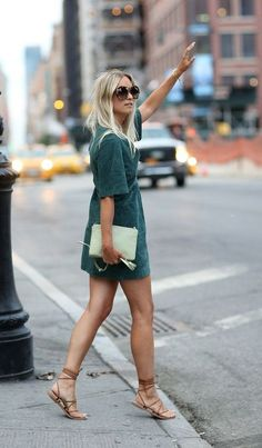 Casual dress and flats with clutch.