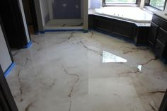 SBR Concrete Bedford Hts, Ohio Reflector Enhancer metallic epoxy floor made to look like marble for a master bathroom floor.