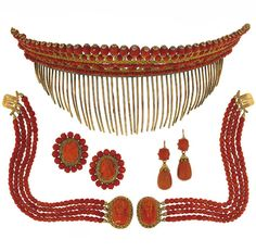 A French 19th century coral suite. Comprising: a haircomb / tiara, a necklace, a pair of bracelets, a pair of earrings and a pair of slides, each with faceted coral, corallium rubrum, beads, the slides and bracelets clasps with carved coral cameos, within floral and cannetille work surrounds, the tiara with foliate scrolls, French marks, in fitted case.