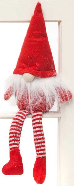 """Sweet little Christmas gnomes with long legs sit perfectly on a shelf. Move it around and cause a little mischief with your own Gnome in the Home. Measures 16.5"""""""