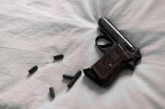 """The bullets?"" He motioned to the pile of empty cartridges on his table. ""Load them up. If you can figure out how."" I gathered the bullets and the cartridges and returned to the bed, kicking off my boots and sitting cross-legged. I smoothed out the dark comforter so the boxes wouldn't spill over. I opened one. The bullet heads were a gray plastic material. I held one up between my fingers. ""I haven't seen these.""--Thief"