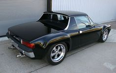 Porsche 914-6. My grandfather had a car very similar to this one. Unfortunatly my father sold it when my grandfather passed. I would've really liked to have had that car.