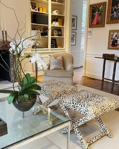 The chic Dallas, texas living room of @tanyafosterblog featuring a spring decor style and leopard as a neutral - two of our favorite source of interior design inspiration right now. Check out the orchids and the styled bookshelf in the background as well as the family gallery photo inspiration. Living Room Inspiration, Interior Design Inspiration, Home Decor Inspiration, Decor Ideas, Texas Living Rooms, Living Room Furniture, Living Room Decor, Fall Color Palette, Upholstered Ottoman