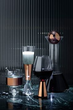 This tank champagne glass with combination of clear glass and hand painted copper detail can be a dramatic and classic touch for your bar cart accessories