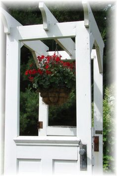 I like this whimsical idea...an arbor made from doors!  Ideal for the porch of my Art Studio!