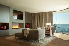 Modern beach house overlooking Laguna Beach - I love the view but the TV is too high. I would lower the fireplace and the TV.