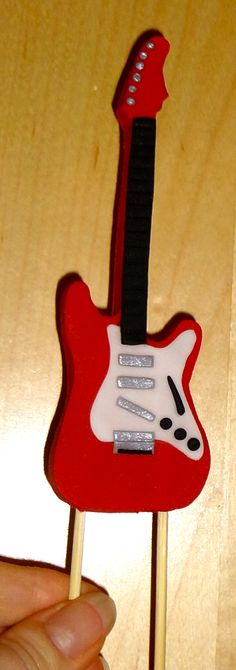 This guitar is made of fondant and goes on top of the Rock & Roll Birthday cake.