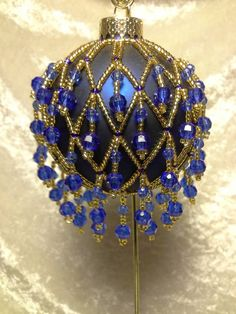 Hey, I found this really awesome Etsy listing at https://www.etsy.com/listing/206053095/blue-and-gold-beaded-christmas-ornament