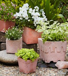Stir up some fun by mixing concrete and adding color. These custom garden pots were created using small disposable milk cartons for the exterior designs and tumblers from the dollar store as inner molds.