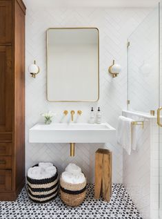 BUILT Design Collective Cara Scarola Santa Fe Interior Design • bathroom, chevron subway tile, pattern tile floor, white, brass