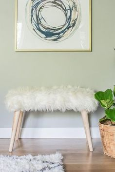 Add some visual interest to your space by making this simple, chic bench. All it takes is a shag rug and a trip to the hardware store.