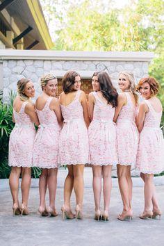 Pink and white lace bridesmaid dresses. | Photo: Corbin Gurkin
