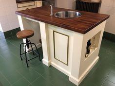 "The Barbisio Kitchen; island in Farrow & Ball ""Tallow"", with oiled Iroko worktop"