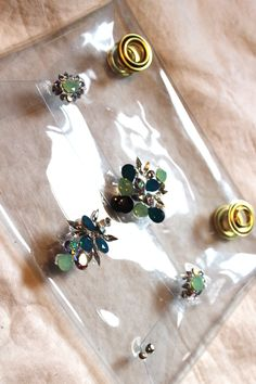 You might be able to tell (from here and here) that I'm really into clear pieces right now.  And so is everyone else.  It's modern, chic, and PVC + lucite just look so good with crystals and embellishment.  I've seen so many incredible DIY PVC clutches throughout the blogsophere (most ...