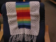 Baby blanket or pram rug. Rainbow centre with white border Hand crochet available at www.woollygoods.com