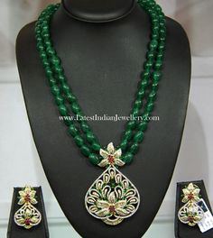 Fancy double stringed emerald beads long chain teamed up with designer unique diamond pendant and earrings set. Party wear emeralds and diamond beads set Gold Jewellery Design, Bead Jewellery, Beaded Jewelry, Jewelery, Beaded Necklace, Choker Necklaces, Fashion Jewellery, Stone Jewelry, Bracelets