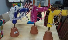 """This """"Hobby Horse"""" head came from Sophie's World. I just used a shorter stick and stuck in a clay pot that I later covered in burlap for horse themed party centerpieces. Pool noodles & Duck tape!"""