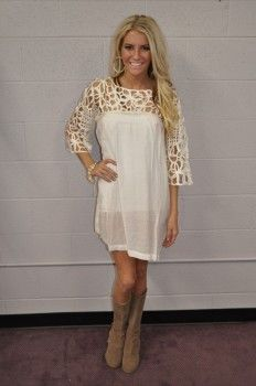 Love this dress! Light/cream color, fun and looks comfy to wear.