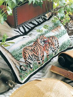"""Cross stitch pattern Tigers Bring a bit of the jungle into your decor with these great tigers. This beautiful design is stitched on a 13""""L x 21""""W piece of potato 25-count Lugana. Instructions are given on how to make the design into a pillow. (aff link)"""