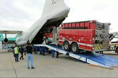 Fire truck being loaded on jet A fire extinguisher would have been cheaper ... but why not?