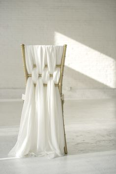 Mrs. Freund & Co. Weaved Romantic Chiffon Chair Sashes  These chair sashes are weaved on a chiavari chair for this gorgeous look.  You will receive a set of 6 thick chiffon sashes. One set of 6 sashes  covers one chair.  Color shown is Ivory and is a photo of our actual product shot by Tyler  Adams Photo.