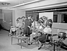 Women drying their hair in the beauty shop at the Crowley-Milner department store | 1941 | #vintage #1940s #hair