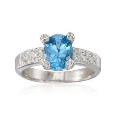 C. 2000 Vintage 1.33 Carat Blue Topaz and .10 ct. t.w. Diamond Ring in 14kt White Gold. Size 7