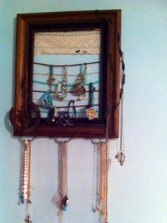 Zoe's jewelry organizer made from old frame, barb wire and horse shoe.