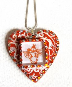 Bevo heart necklace.  $40.00 from Hippiechicjewelz' Etsy shop.
