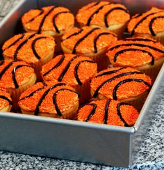 Basketball cupcake decorating tutorial  How cute would these be with red licorice for baseballs?