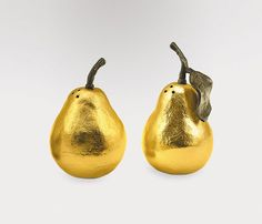 """Decorative Salt & Pepper Shakers """"Pear"""" from Neiman Marcus.  Whether you're dressing your tabletop to the nines to host a dinner party of your own, or heading out to be served at a friend's, the """"Pear"""" decorative salt and pepper shakers make a great gift any time of year. Designed by artist Michael Aram (who mastered traditional metalworking in India), these gilded fruit shakers bring a bit of understated sparkle to any table."""