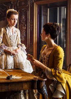 Rosie Day & Caitriona Balfe in 'Outlander'