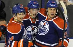 Edmonton Oilers' Jordan Eberle, Ryan Nugent-Hopkins and Ryan Jones celebrate a goal against the Calgary Flames during the third period of their NHL hockey game in Edmonton March 16, 2012