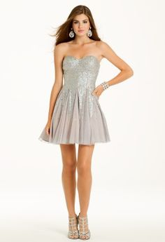 Strapless sweetheart sequin party dress with mesh godets.<br><br><br>��Strapless sweetheart neckline<br>��Fit and flare bodice<br>��Full sequin and mesh skirt<br>��Open back with center zipper