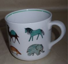 Vintage Arabia Finland child's animal mug. A teal green horse...