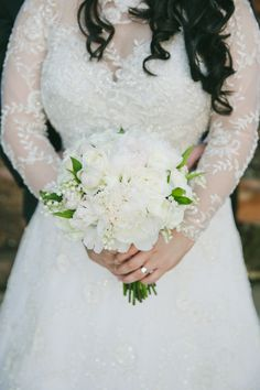 White bouquet and a gorgeous beaded gown: http://www.stylemepretty.com/little-black-book-blog/2015/03/31/elegant-saint-helena-vineyard-wedding/ | Photography: Onelove - http://www.onelove-photo.com/