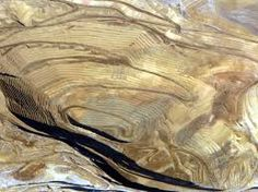 Round Mountain gold mine, Located in Big Smokey Valley. Round Mountain is best known for the Round Mountain Gold Mine, a large open pit heap-leach gold mine owned by Kinross Gold Corporation owner and operator) and Barrick Gold Corporation owned