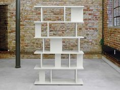 The Arie Shelving System in white comes in two different sizes. Due to this, the Arie can either be a bookcase, room divider, sideboard or storage unit. Modular Walls, Modular Shelving, Shelving Systems, Room Divider Shelves, Bookcase Shelves, Wall Shelves, Room Dividers, Shelving Design, Shelf Design