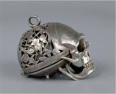 The Seton watch, given to Mary Seton by Mary Queen of Scots. If you hold the skull held upside down and lift the jaw, the dial is revealed. 16th century.