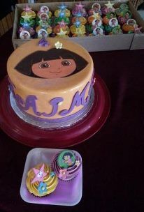 Dora themed chocolate cake with matching cupcakes www.facebook.com/probst.willi.bakery