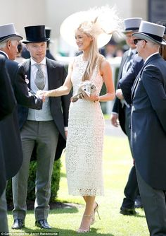 Heavenly display: The Australian TV producer dressed her lean and slender frame in a stunning white figure-hugging number