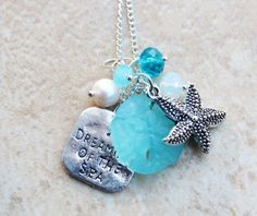 Striking Light Aqua Seaglass Sand Dollar Silver by InaraJewels