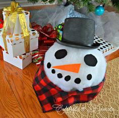 Mr. Snowman is a clever way to wrap an odd shaped gift.