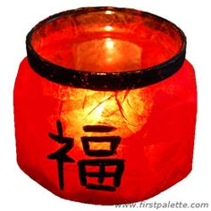 Create a Chinese lantern-like candle holder by decorating a glass jar with red tissue paper and acrylic paint!