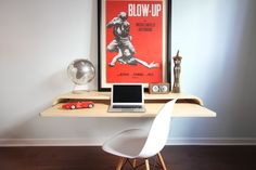 Float Wall Desk mounts easily to any wall type to create a multi-use desk or display shelf. Perfect laptop station, full desktop station or writing desk. Design accommodates use at standing height or traditional sitting height. Clever use of geometry and physics eliminates legs while providing a full surface slide out tray and wire management slot.