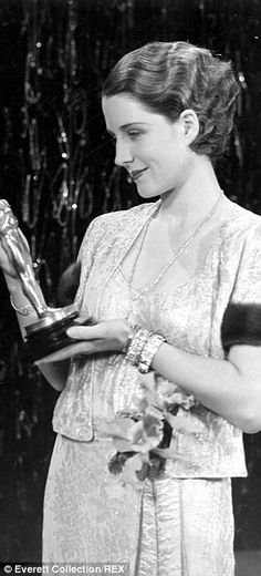 Norma Shearer wears an outfit with fur-trimmed sleeves in 1931 when she won the Oscar for The Divorce.