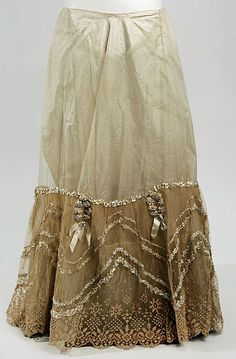 Petticoat Date: 1890s Culture: American Medium: silk, cotton Dimensions: Length at CB: 41 in. (104.1 cm) Credit Line: Gift of Mrs. Harry T. Peters, 1950 Accession Number: C.I.50.1.3