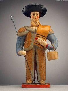 Pastor de manta ao ombro, com tarro e cajado (15,5 x 7,8 cm). Autor desconhecido (séc. XX). Museu Nacional de Etnologia, Lisboa