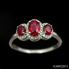 Fabulous 3 stone ruby and diamond ring in 18ct white gold. This beautiful design comprises of 3 x oval cut rubies(1.16ct total) each surrounded by a round cut diamond border (.13ct total). The centre stones are claw set on a low mount and narrow shank, a modern twist on a traditional design. £895
